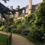 garden plants border the 13th century cottages